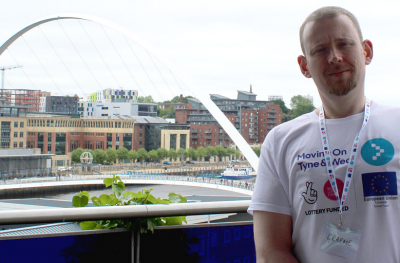 Graeme standing in front of Millennium Bridge