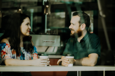 Two people sitting and talking in a cafe