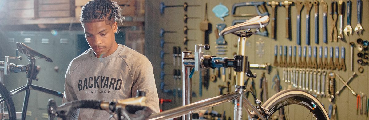 Man working on a bike at his job