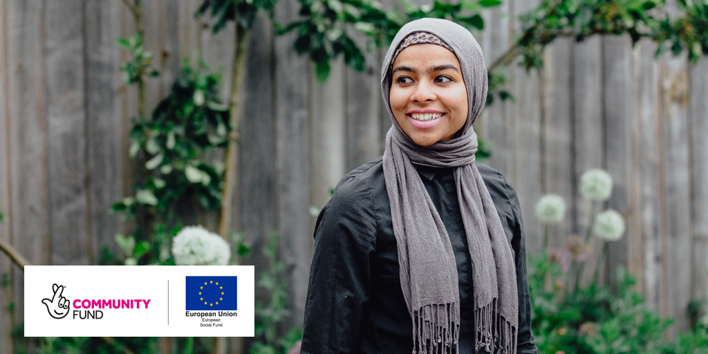 Young woman in headscarf smiling into the distance