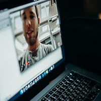 close up of a screen showing a video call with a male