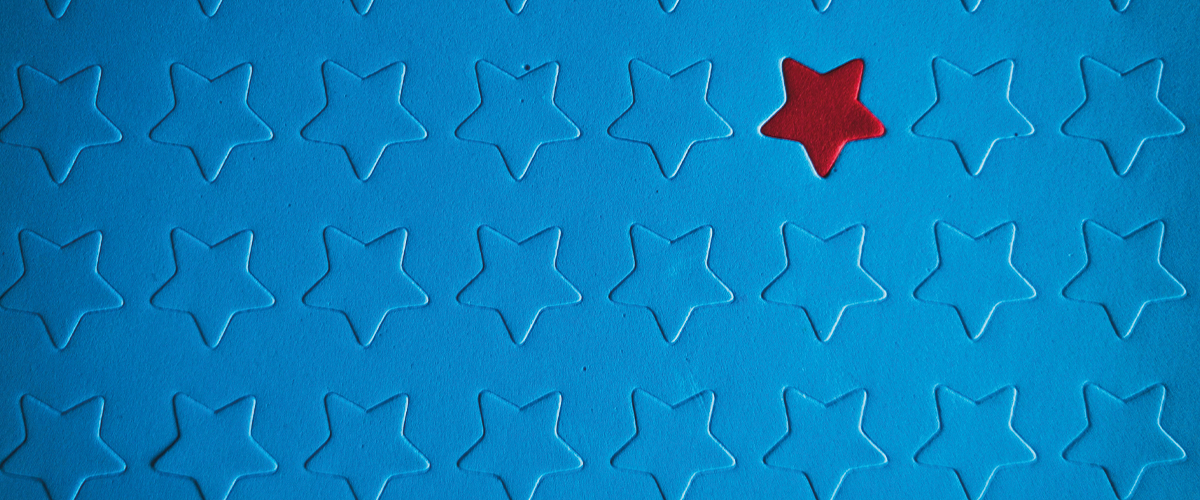 Blue material with embossed blue stars and one red star