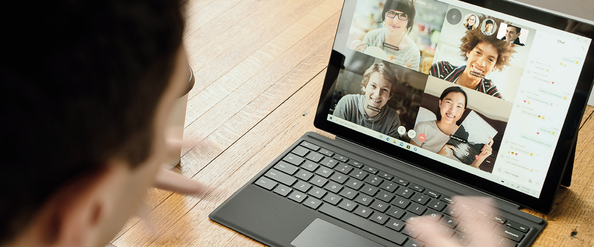 Laptop screen showing four people on a video call